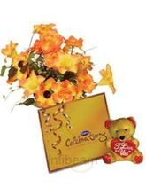 Teddy With Silk Artificial Flowers And Chocolates