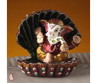 Ganesh Murthi Seated In A Sea Shell Made In Ceramic (Multicolor)